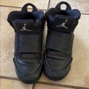 Boys son of mars black Jordans.